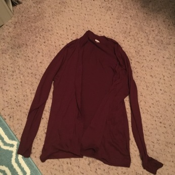 Burgundy cardigan - only got it out to go with a dress to a wedding during the first three months of the year - had a hole by the end of the night so didn't wear it again